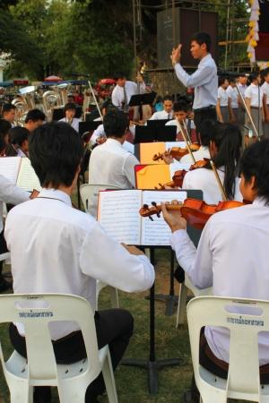 MUANG, MAHASARAKHAM - DECEMBER 5 : Unidentified collegians of Mahasarakham university are performing symphony orchestra for celebration the king