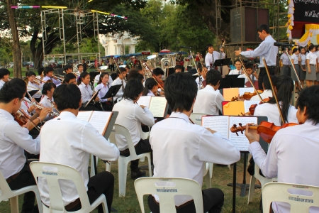 collegian: MUANG, MAHASARAKHAM - DECEMBER 5 : Unidentified collegians of Mahasarakham university are performing symphony orchestra for celebration the kings birthday on December 5, 2012 at city hall plaza, Muang, Mahasarakham, Thailand.