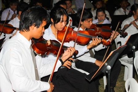collegian: MUANG, MAHASARAKHAM - DECEMBER 5 : Unidentified collegians of Mahasarakham university are performing symphony orchestra for celebration the king