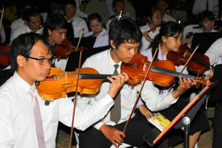 MUANG, MAHASARAKHAM - DECEMBER 5 : Unidentified collegians of Mahasarakham university are performing symphony orchestra for celebration the king Stock Photo - 16768886