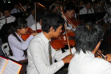 MUANG, MAHASARAKHAM - DECEMBER 5 : Unidentified collegians of Mahasarakham university are performing symphony orchestra for celebration the king