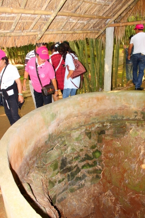 VINH MOC, QUANG TRI, VIETNAM - DECEMBER 10 : Unidentified tourists are looking at chimney of underground tunnel used during B52 carpet bombing between Vietnam war on December 10, 2012 at Vinh Moc, Quang Tri, Vietnam.