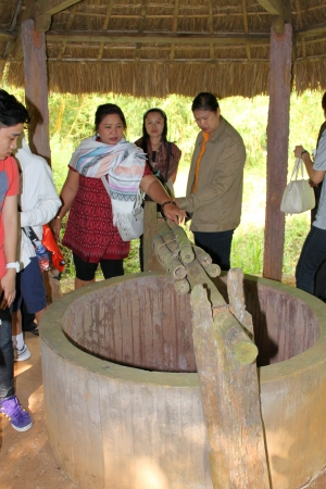 VINH MOC, QUANG TRI, VIETNAM - DECEMBER 10 : Unidentified tourists are looking at hoist of underground tunnel used during B52 carpet bombing between Vietnam war on December 10, 2012 at Vinh Moc, Quang Tri, Vietnam.