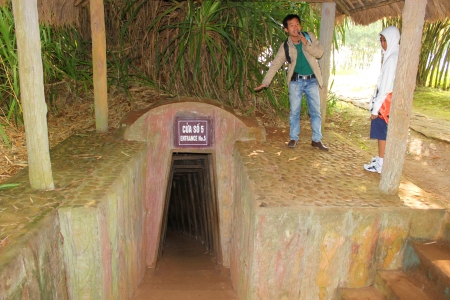 VINH MOC, QUANG TRI, VIETNAM - DECEMBER 10 : Unidentified Vietnam guide is giving tourists the information about underground tunnel used during B52 carpet bombing between Vietnam war on December 10, 2012 at Vinh Moc, Quang Tri, Vietnam.