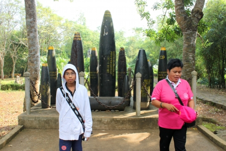 VINH MOC, QUANG TRI, VIETNAM - DECEMBER 10 : Unidentified tourists are taking photograph in front of misfire bombs on December 10, 2012 at Vinh Moc museum, Quang Tri, Vietnam.