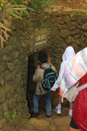 VINH MOC, QUANG TRI, VIETNAM - DECEMBER 10 : Unidentified tourists are following Vietnam guide into underground tunnel used during B52 carpet bombing between Vietnam war on December 10, 2012 at Vinh Moc, Quang Tri, Vietnam.