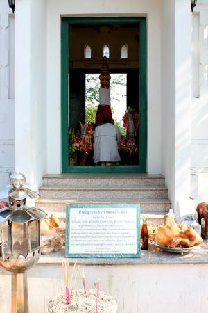 glorify: MUANG, MAHASARAKHAM - DECEMBER 12 : Unidentified man is worshipping the shrine of city pillar on DECEMBER 12, 2012 at The shrine of city pillar, Muang, Mahasarakham, Thailand.