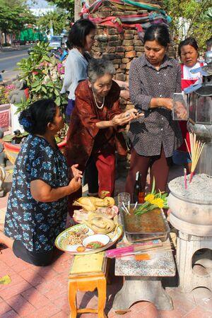 glorify: MUANG, MAHASARAKHAM - DECEMBER 12 : Unidentified women are worshipping the shrine of city pillar on DECEMBER 12, 2012 at The shrine of city pillar, Muang, Mahasarakham, Thailand.
