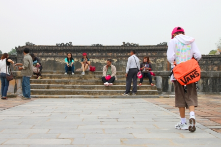HUE, VIETNAM - DECEMBER 8 : Unidentified tourists are relaxing in Dai Noi Palace on DECEMBER 8, 2012 at Hue, Central Vietnam. Dai Noi Palace may be called The Imperial EnclosureThe Citadel Palace or The Purple Forbidden City in Hue City of Viet Nam.