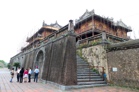 HUE, VIETNAM - DECEMBER 8 : Unidentified tourists are treveling to Dai Noi Palace on DECEMBER 8, 2012 at Hue, Central Vietnam. Dai Noi Palace may be called The Imperial EnclosureThe Citadel Palace or The Purple Forbidden City in Hue City of Viet Nam.