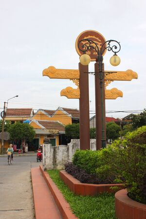 Song Hoai Square of the world heritage and ancient town on December 8, 2012 at Hoi An, Vietnam. So wonderful with old aged traditionally kept cultural activities, habits and customs, Hoai An town is now a wonderful living urban lifestyle.  Stock Photo - 16919741