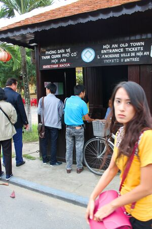 HOI AN, CENTRAL VIETNAM - DECEMBER 8 : Unidentified tourists are buying entrance tickets and traveling to the world heritage and ancient town on December 8, 2012 at Hoi An, Vietnam. So wonderful with old aged traditionally kept cultural activities, habits Stock Photo - 16919747