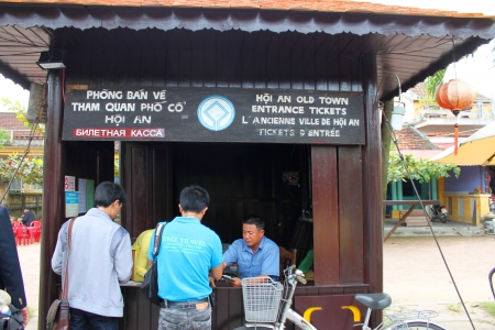 HOI AN, CENTRAL VIETNAM - DECEMBER 8 : Unidentified tourists are buying entrance tickets and traveling to the world heritage and ancient town on December 8, 2012 at Hoi An, Vietnam. So wonderful with old aged traditionally kept cultural activities, habits Stock Photo - 16919754