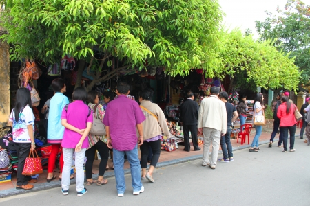 HOI AN, CENTRAL VIETNAM - DECEMBER 8 : Unidentified tourists are traveling to the world heritage and ancient town on December 8, 2012 at Hoi An, Vietnam. So wonderful with old aged traditionally kept cultural activities, habits and customs, Hoai An town i Stock Photo - 16919779