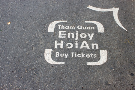 Buy entrance tickets telling way sign on walking road to the world heritage and ancient town on December 8, 2012 at Hoi An, Vietnam. So wonderful with old aged traditionally kept cultural activities, habits and customs, Hoai An town is now a wonderful liv Stock Photo - 16919781