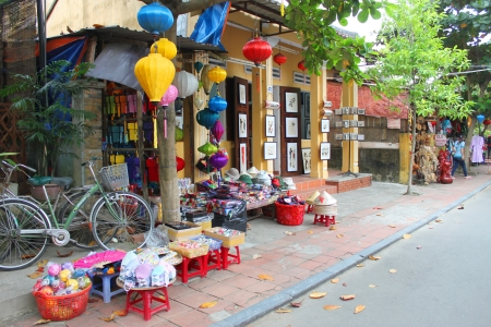 Old house, walking and cycling street, shopping and trade centre of the world heritage and ancient town on December 8, 2012 at Hoi An, Vietnam. So wonderful with old aged traditionally kept cultural activities, habits and customs, Hoai An town is now a wo