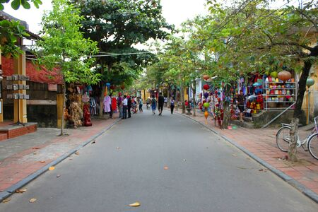 communual: HOI AN, CENTRAL VIETNAM - DECEMBER 8 : Unidentified tourists are traveling to old house, walking and cycling street, shopping and trade centre of the world heritage and ancient town on December 8, 2012 at Hoi An, Vietnam. So wonderful with old aged tradit