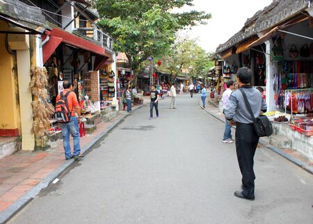 communual: Old house, walking and cycling street, shopping and trade centre of the world heritage and ancient town on December 8, 2012 at Hoi An, Vietnam. So wonderful with old aged traditionally kept cultural activities, habits and customs, Hoai An town is now a wo