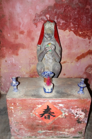 communual: Animal statue in Japanese covered bridge of the world heritage and ancient town on December 8, 2012 at Hoi An, Vietnam. So wonderful with old aged traditionally kept cultural activities, habits and customs, Hoai An town is now a wonderful living urban lif