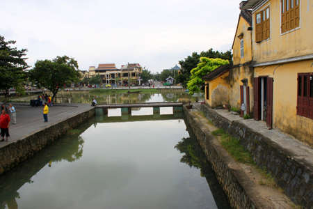 communual: View from Japanese covered bridge on the bank of Hoai River on December 8, 2012 at Hoi An, Vietnam. So wonderful with old aged traditionally kept cultural activities, habits and customs, Hoai An town is now a wonderful living urban lifestyle.