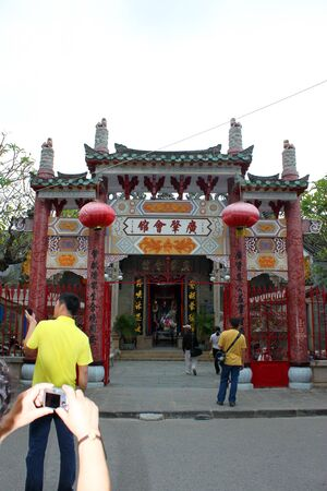 communual: HOI AN, CENTRAL VIETNAM - DECEMBER 8 : Unidentified tourists are traveling to Quang Trieu Assembly Hall on December 8, 2012 at Hoi An, Vietnam. So wonderful with old aged traditionally kept cultural activities, habits and customs, Hoai An town is now a wo