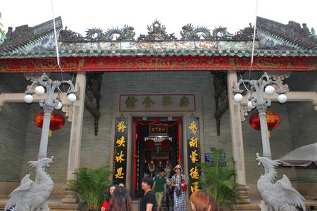 communual: HOI AN, CENTRAL VIETNAM - DECEMBER 8 : Unidentified tourists are traveling to Quang Trieu Assembly Hall on December 8, 2012 at Hoi An, Vietnam. In the 19 th century, the Cantonese in Hoi An built Quang Trieu Assembly Hall as meeting place and a temple for Editorial