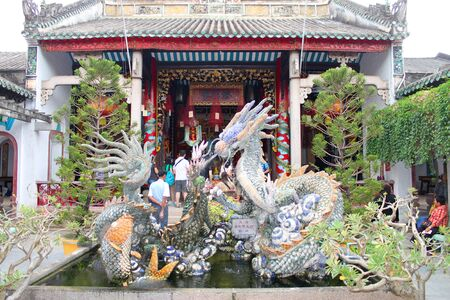 communual: Dragon statue in Quang Trieu Assembly Hall on December 8, 2012 at Hoi An, Vietnam. In the 19 th century, the Cantonese in Hoi An built Quang Trieu Assembly Hall as meeting place and a temple for the worship of their gods and goddesses. So wonderful with o