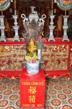 meeting place: Religious statue in Quang Trieu Assembly Hall on December 8, 2012 at Hoi An, Vietnam. In the 19 th century, the Cantonese in Hoi An built Quang Trieu Assembly Hall as meeting place and a temple for the worship of their gods and goddesses. So wonderful wit