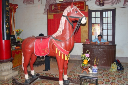 communual: Horse statue in Quang Trieu Assembly Hall on December 8, 2012 at Hoi An, Vietnam. In the 19 th century, the Cantonese in Hoi An built Quang Trieu Assembly Hall as meeting place and a temple for the worship of their gods and goddesses. So wonderful with ol