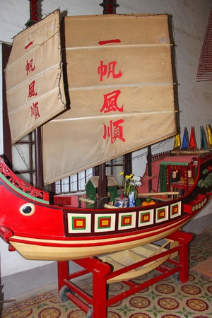 communual: Imitated ship in Quang Trieu Assembly Hall on December 8, 2012 at Hoi An, Vietnam. In the 19 th century, the Cantonese in Hoi An built Quang Trieu Assembly Hall as meeting place and a temple for the worship of their gods and goddesses. So wonderful with o Editorial