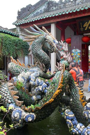 meeting place: Dragon statue in Quang Trieu Assembly Hall on December 8, 2012 at Hoi An, Vietnam. In the 19 th century, the Cantonese in Hoi An built Quang Trieu Assembly Hall as meeting place and a temple for the worship of their gods and goddesses. So wonderful with o