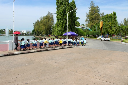 MUANG, ROI-ET - NOVEMBER 14 : Unidentified group of young pupils are traveling to Bung Palanchai public park on November 14, 2012 at Roi-et, Thailand.