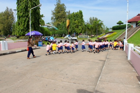 MUANG, ROI-ET - NOVEMBER 14 : Unidentified teacher and group of young pupils are traveling to Bung Palanchai public park on November 14, 2012 at Roi-et, Thailand.