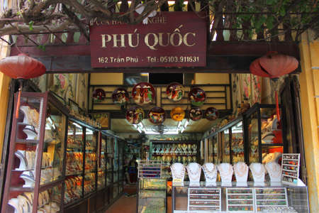 Shopping and trading center on walking street and cycling of world heritage old town on December 8, 2012 at Hoi An, Vietnam. So wonderful with old aged traditionally kept cultural activities, habits and customs, Hoai An town is now a wonderful living urba Stock Photo - 16972917