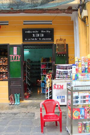 Shopping and trading center on walking street and cycling of world heritage old town on December 8, 2012 at Hoi An, Vietnam. So wonderful with old aged traditionally kept cultural activities, habits and customs, Hoai An town is now a wonderful living urba Stock Photo - 16972929