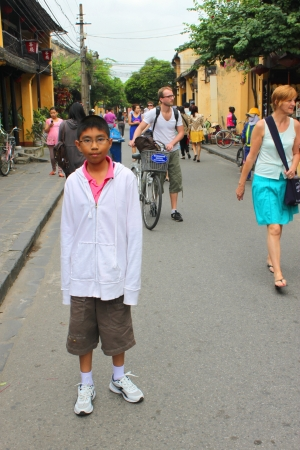 communual: HOI AN, CENTRAL VIETNAM - DECEMBER 8 : Unidentified tourists are shopping on walking street and cycling of world heritage old town on December 8, 2012 at Hoi An, Vietnam. So wonderful with old aged traditionally kept cultural activities, habits and custom