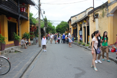 emporium: HOI AN, CENTRAL VIETNAM - DECEMBER 8 : Unidentified tourists are shopping on walking street and cycling of world heritage old town on December 8, 2012 at Hoi An, Vietnam. So wonderful with old aged traditionally kept cultural activities, habits and custom