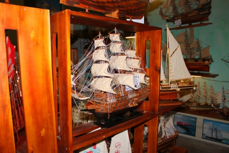 communual: Ship model as famous souvenirs in shop on walking street and cycling of world heritage old town on December 8, 2012 at Hoi An, Vietnam. So wonderful with old aged traditionally kept cultural activities, habits and customs, Hoai An town is now a wonderful