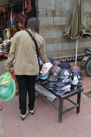 communual: HOI AN, CENTRAL VIETNAM - DECEMBER 8 : Unidentified tourist is shopping on walking street and cycling of world heritage old town on December 8, 2012 at Hoi An, Vietnam. So wonderful with old aged traditionally kept cultural activities, habits and customs,