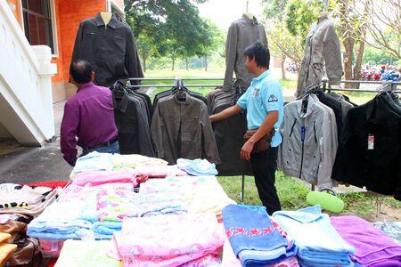 travelling salesman: MUANG, MAHASARAKHAM - OCTOBER 2 : Unidentified travelling salesman is selling clothes in local market on October 2, 2012 at city hall ground, Muang, Mahasarakham, Thailand. Editorial