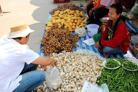 PAYAKKAPHUMPHISAI, MAHASARAKHAM - FEBRUARY 25 : Unidentified villagers are shopping in local market on February 25, 2012 at city hall ground, Payakkaphumphisai, Mahasarakham, Thailand. Stock Photo - 17063336