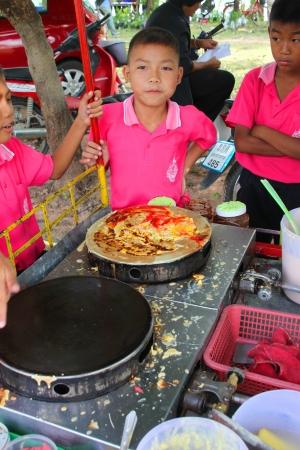 travelling salesman: MUANG, MAHASARAKHAM - SEPTEMBER 22 : Unidentified boys are buying sweetmeat on September 22, 2012 at Don Whan school, Don Whan, Muang, Mahasarakham, Thailand.