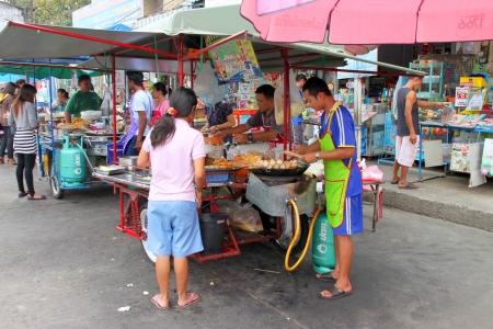 MUANG, BURIRAM - JANUARY 3 : The unidentified woman is buying meat balls on January 3, 2012 at local market, Muang, Buriram, Thailand. Stock Photo - 17063355