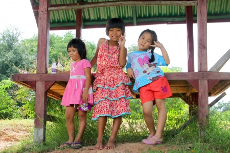 MUANG, MAHASARAKHAM - SEPTEMBER 22 : Unidentified girls are sending victory sign to tourists on September 22, 2012 at local village of Don Whan, Muang, Mahasarakham, Thailand. Stock Photo - 17063358