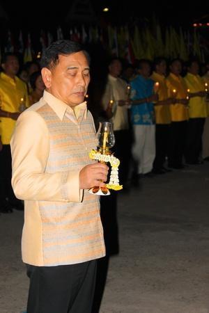 ix portrait: MUANG, MAHASARAKHAM - DECEMBER 5 : Provincial governor, Mr.Noppawat Singhsakda is celebrating the king Rama IX birthday on December 5, 2012 at city hall ground, Muang, Mahasarakham, Thailand.