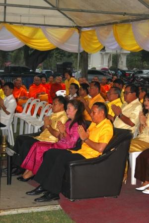 ix portrait: MUANG, MAHASARAKHAM - DECEMBER 5 : Provincial governor, Mr.Noppawat Singhsakda and people are making religious merit and celebrating the king Rama IX birthday on December 5, 2012 at city hall ground, Muang, Mahasarakham, Thailand.
