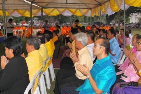 MUANG, MAHASARAKHAM - DECEMBER 5 : Unidentified people are making religious merit and celebrating the king Rama IX birthday on December 5, 2012 at city hall ground, Muang, Mahasarakham, Thailand. Stock Photo - 17118487
