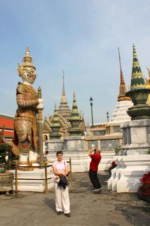 BANGKOK, THAILAND - JANUARY 5 : Unidentified tourists are taking photograph in Wat Phra Kaew on January 5, 2013 at Grand Palace, Bangkok, Thailand.