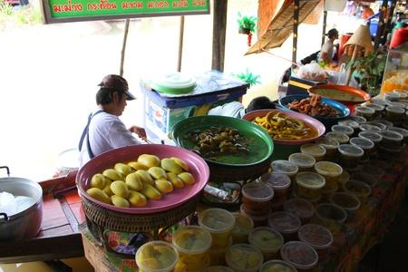 AYUTTHAYA, THAILAND - JANUARY 6 : Unidentified man is selling food in Ayothaya Floating Market on January 6, 2013 at Ayutthaya, Thailand. Stock Photo - 17262754