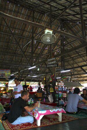 ayothaya: AYUTTHAYA, THAILAND - JANUARY 6 : Unidentified tourists are having lunch in Ayothaya Floating Market on January 6, 2013 at Ayutthaya, Thailand.